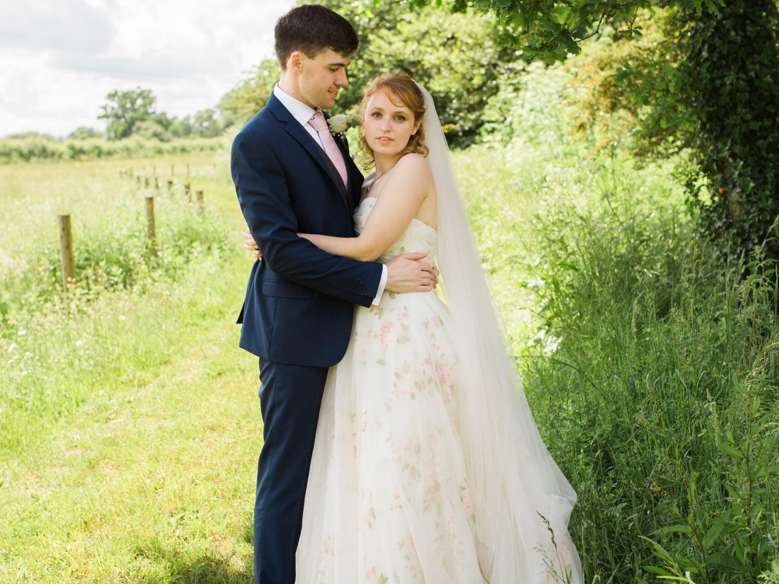 Rose-covered dress by Loulou Bride